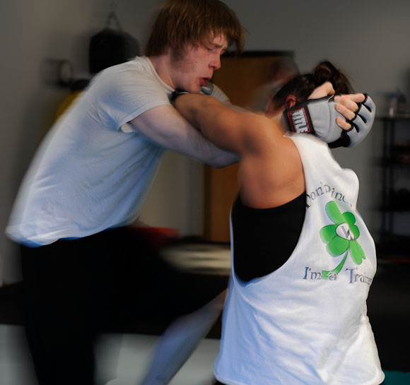 Kevin Croom tries to place Kristin Rambo into a headlock during a sparring match at the Hulett House Gym on April 22, 2009, in Columbia, Mo.  Croom, who is yet undefeated in his mixed-martial arts career, is helping to get Rambo ready for her first Midwest Fight League contest on May 25.