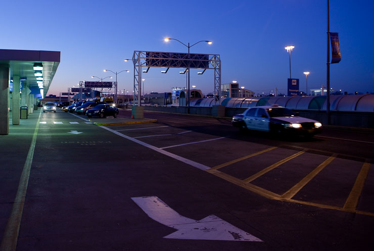 Florescent, Tungsten and Pre-dawn light mix at the arrivals lane at Lambert International Airport, St. Louis, Mo.
