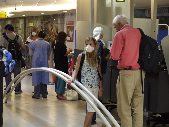 Preventing H1N1 at the Quito airport.  Everyone deplaning from my flight had to wear them.  They were unbearably hot.