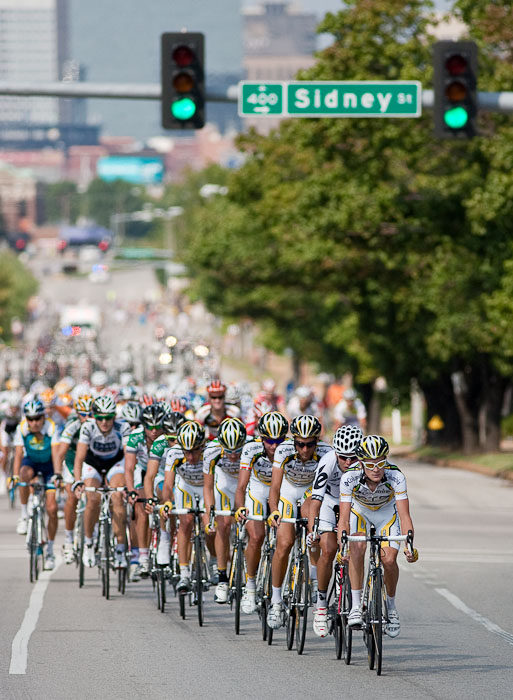 Members of Team Columbia-HTC and a lone member of Team Cervelo move to the front of the pack as they work their way along 7th Street in St. Louis as part of the 7.5 mile circuit of the first stage of the Tour of Missouri on Monday. The first stage was won by Britain's Mark Cavendish, competing for Columbia-HTC, and consisted of ten laps of the circuit.   Canon 1D IIN and 300mm f/4L lens; exposed 1/5000 sec. @ f/4, ISO 400.