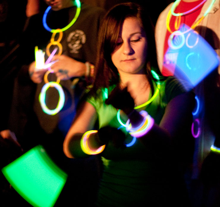 Luba Korshunova, a student from the University of Missouri-St. Louis, twirls glow sticks before the start of the Bassnectar concert.