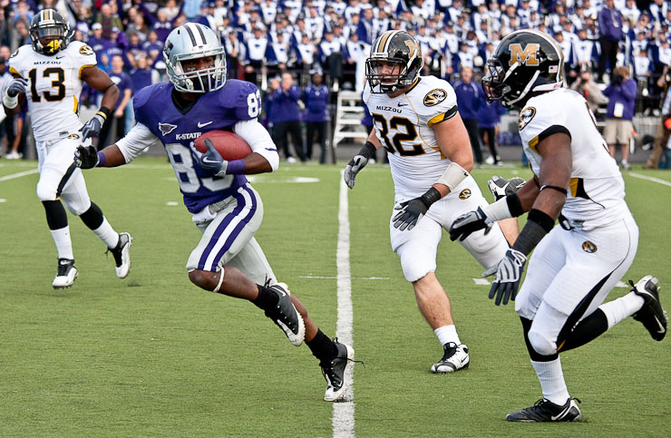 Kansas State Wildcats' wide receiver, Brandon Banks, attempts to evade the Missouri Tigers' defensive back Kenji Jackson, left, line backer Will Ebner, and safety Jasper Simmons during the fourth quarter on Nov. 14, 2009 in Manhattan, Kan.  Missouri defeated Kansas State 38 to 12.