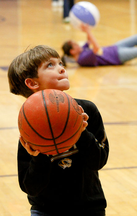Jackson Kespohl, 6, aims for the basketball hoop during half-time at the Hickman High School vs. Helias women's basketball game on Thursday, Dec. 3, 2009 in Columbia, Mo. | Canon 7D and 70-200mm f/4L IS lens @ 81mm; exposed 1/400 @ f/4, ISO 3200.