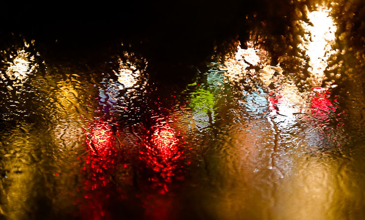 Freezing rain on a car windshield.