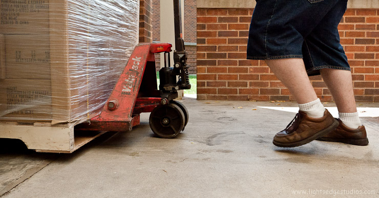 A pallet of my books rolls off of the truck and into the Faulconer Gallery's loading dock.