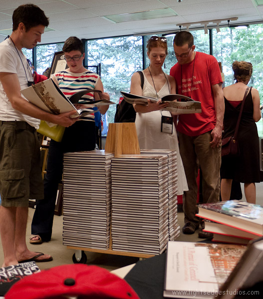 Alumni page through my book during the book signing at the Grinnell College Bookstore on Saturday, June 4, 2011 in Grinnell, Iowa.