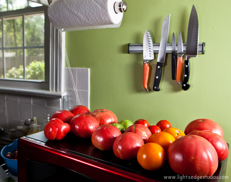 Knives loom over our ripening tomatoes.