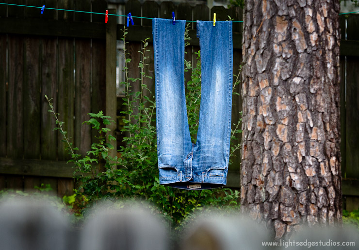 Jeans hang to dry on a clothes line in Durham, NC.